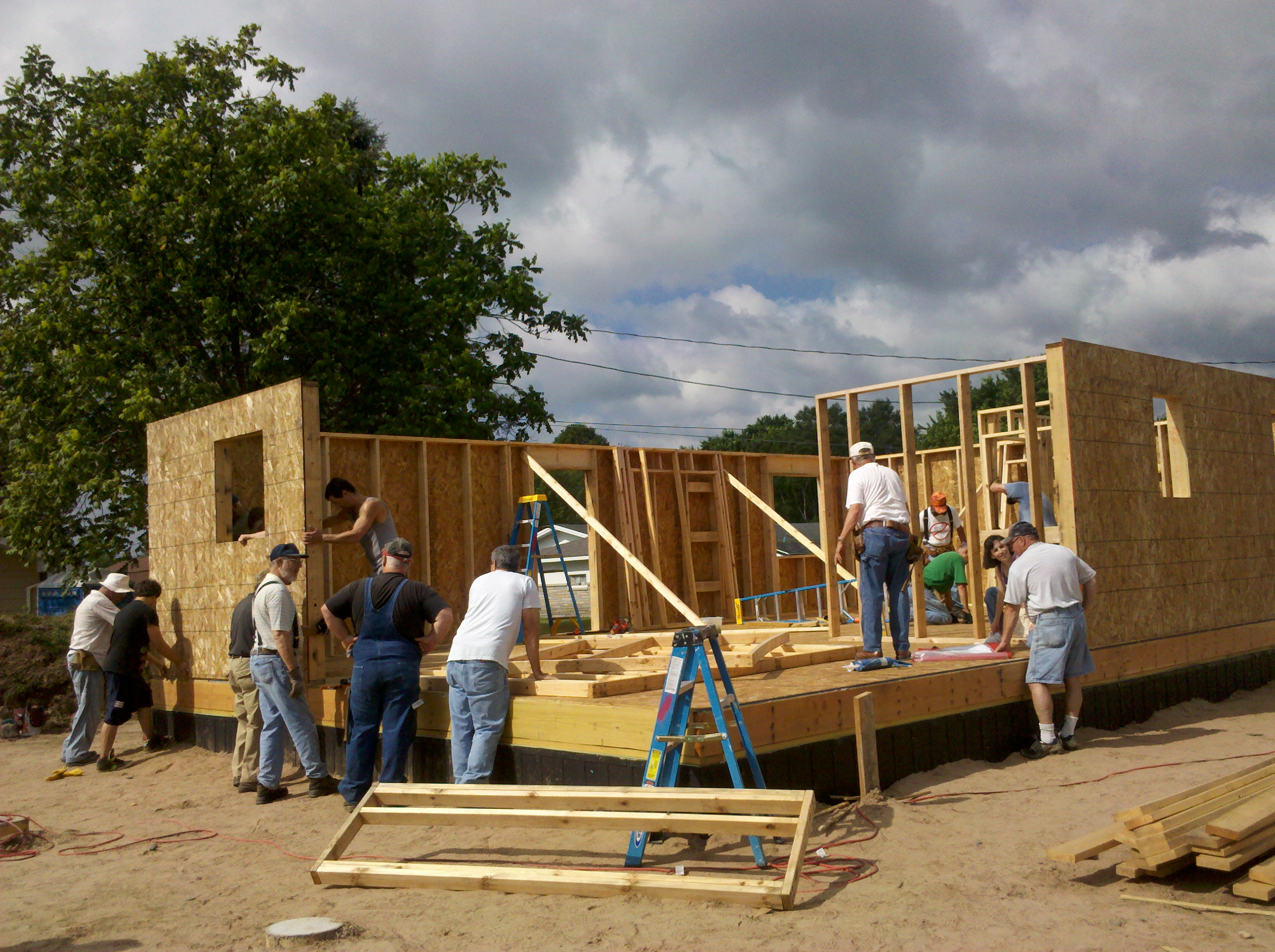 Volunteers putting walls up